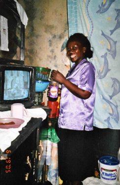 Hellen cooking in her kitchen corner, 2005